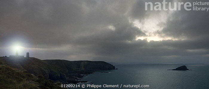 The lighthouse at Cap Frehel at night, Brittany, France. Digital composite. May 2008.  ,  CLOUDS,COASTS,DIGITAL COMPOSITE,EUROPE,FRANCE,LANDSCAPES,LIGHT,PANORAMIC,SILHOUETTES,Weather  ,  Philippe Clement