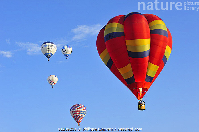 Balloonists in hot-air balloons during ballooning meeting, Eeklo, Belgium. July 2008.  ,  BALLOON,BELGIUM,COLOURFUL,EUROPE,FIVE,GROUPS,LEISURE,RED,SKY  ,  Philippe Clement