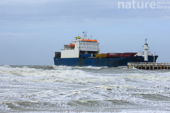 Container ship entering port during storm, North Sea, Ostend, Belgium. March 2008.  ,  BELGIUM,BOATS,COASTAL WATERS,COASTS,CONTAINER SHIPS,EUROPE,FREIGHT BOATS ,HARBOUR,ROUGH SEAS,STORMS,TRANSPORT,WAVES,Weather, WORKING-BOATS , WORKING-BOATS  ,  Philippe Clement