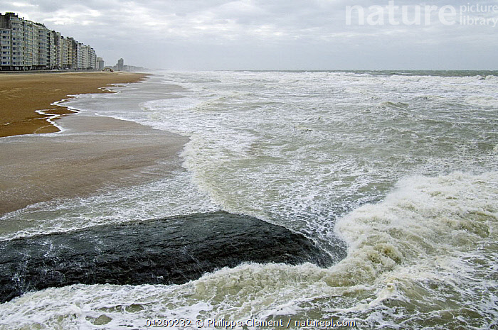 Developed coastline of Ostend with beach, appartment buildings and breakwater along the North Sea coast during winter storm, Belgium, March 2008  ,  BEACHES,BELGIUM,BUILDINGS,COASTS,EUROPE,LANDSCAPES,STORMS,TOWNS,WAVES,WEATHER  ,  Philippe Clement