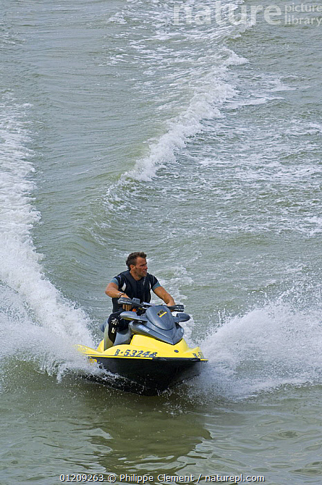 Man riding jet ski on the North Sea, Belgium, 2008.  ,  BELGIUM,BOATS,COASTAL WATERS,EUROPE,LEISURE,PEOPLE,VERTICAL  ,  Philippe Clement