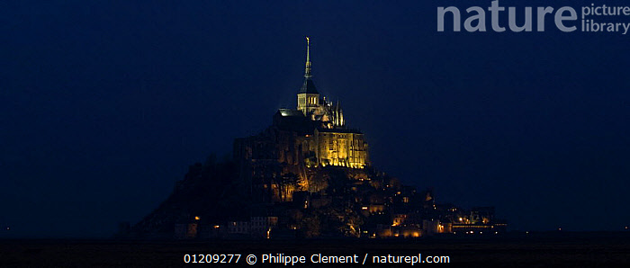 The Mont Saint Michel abbey floodlit at night, Normandy, France. 2008.  ,  BUILDINGS,CHURCHES,COASTS,EUROPE,FRANCE,LANDSCAPES,LIGHT,NIGHT  ,  Philippe Clement