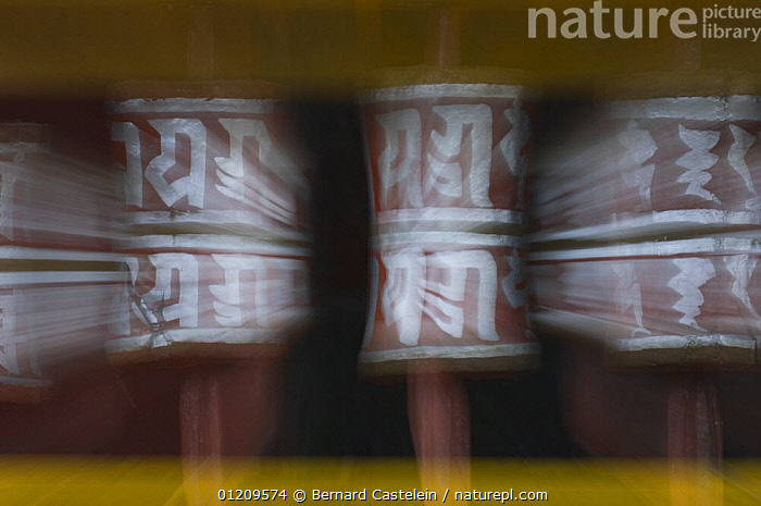 Prayer wheels on the outside of Labrang Monastery, 