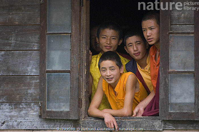 Young Buddhist monks looking out of window, Labrang Monastery, Phodong, Sikkim, India October 2007  ,  ASIA,BOYS,BUDDHISM,BUDDHIST,BUILDINGS,CHILDREN,FOUR,GROUPS,INDIA,MONK,PEOPLE,INDIAN-SUBCONTINENT  ,  Bernard Castelein