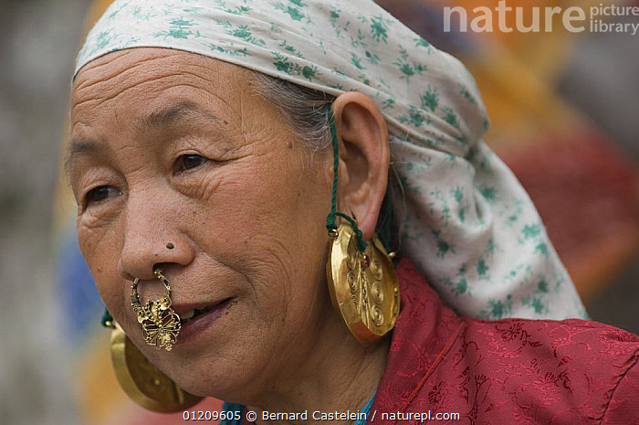 Woman (of Nepali origin) wearing gold jewellery in nose and ears at the street market of Sombare, West Sikkim, India October 2007  ,  ASIA,EARRINGS,FACES,INDIA,JEWELRY,PEOPLE,PORTRAITS,WOMEN  ,  Bernard Castelein