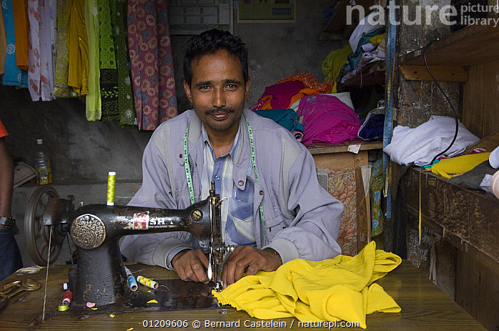 Tailor with sewing maching in the street market of Sombare, West Sikkim, India October 2007  ,  ASIA,CLOTHES,INDIA,MEN,PEOPLE,SEWING,TRADITIONAL  ,  Bernard Castelein