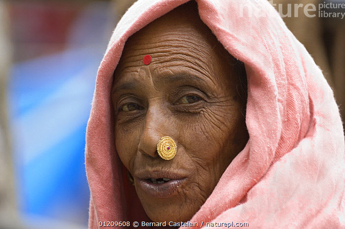 Woman (of Nepali origin) with nose jewellery at the market of Sombare, West Sikkim, India October 2007  ,  ASIA,FACES,INDIA,JEWELRY,PEOPLE,WOMEN,INDIAN-SUBCONTINENT  ,  Bernard Castelein