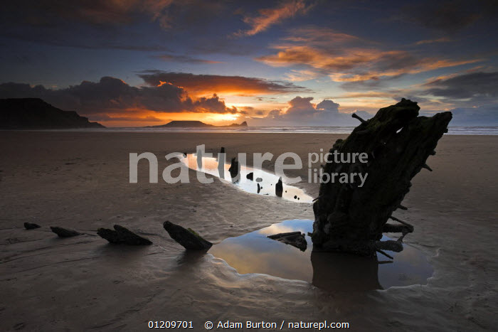 Rhossili Bay, with wreck of the Helvetia buried in the sand and Worm's Head on the horizon, Gower, Wales  ,  BEACHES,COASTS,EUROPE,LANDSCAPES,PEACEFUL,POOLS,SHIPWRECK,SHIPWRECKS,SUNRISE,SUNSET,UK,WRECKS,United Kingdom,Concepts,British,WALES, United Kingdom, United Kingdom, United Kingdom  ,  Adam Burton