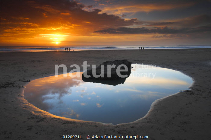 Rockpool and people at sunset, Dunraven Bay, Southerndown, Wales *Not available for 2013 trade calendar use in France*  ,  BEACHES,COASTS,EUROPE,LANDSCAPES,PEACEFUL,PEOPLE,REFLECTIONS,RELAXING,ROCKS,SUNSET,TIDEPOOL,UK,United Kingdom,Concepts,British,WALES, United Kingdom, United Kingdom, United Kingdom  ,  Adam Burton