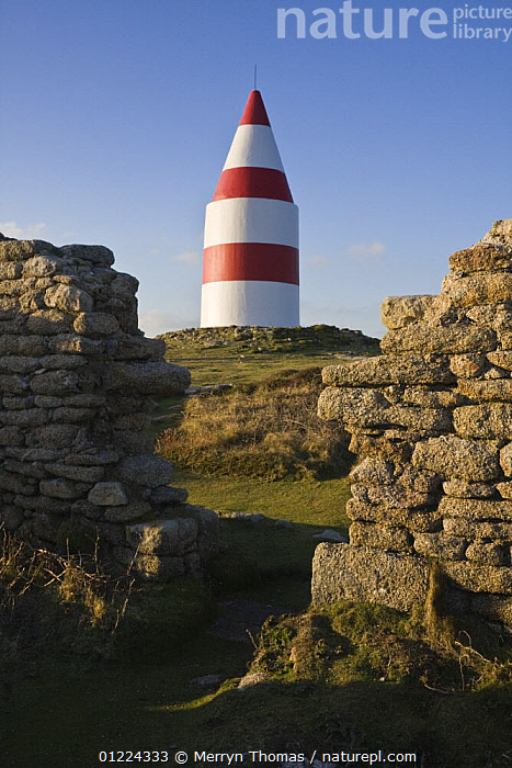 The Daymark, erected in 1683, viewed through gap in wall of ruined cottages. Chapel Down, St.Martin's, Isles of Scilly. December 2008.  ,  BUILDINGS,COASTS,CORNWALL,DAYMARKS ,ENGLAND,EUROPE,HISTORICAL,LANDSCAPES,MARKERS,MOORLAND,RUINS,SAINT MARTINS,STRIPES,UK,WINTER,NAVIGATION, United Kingdom, United Kingdom, United Kingdom, United Kingdom  ,  Merryn Thomas