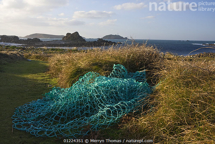 Fishing nets beside the footpath at Pernagie, St. Martin's, looking towards the Round Island Lighthouse. December 2008.  ,  COASTS,CORNWALL,EUROPE,LANDSCAPES,SAINT MARTINS,UK,ENGLAND, United Kingdom, United Kingdom, United Kingdom  ,  Merryn Thomas