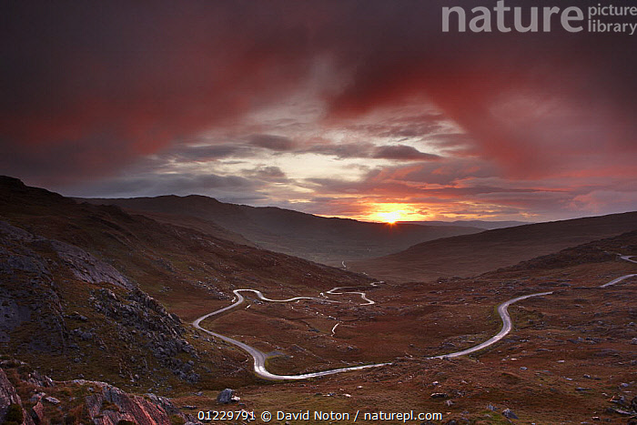 The road over the Healy Pass at dawn, Caha Mountains, Beara Peninsula, Co Cork, Ireland, October 2008, COUNTRYSIDE,DAWN,DRAMATIC,EUROPE,IRELAND,LANDSCAPES,MOORLAND,MOUNTAINS,RED,ROADS,SUNRISE,CONCEPTS, David Noton