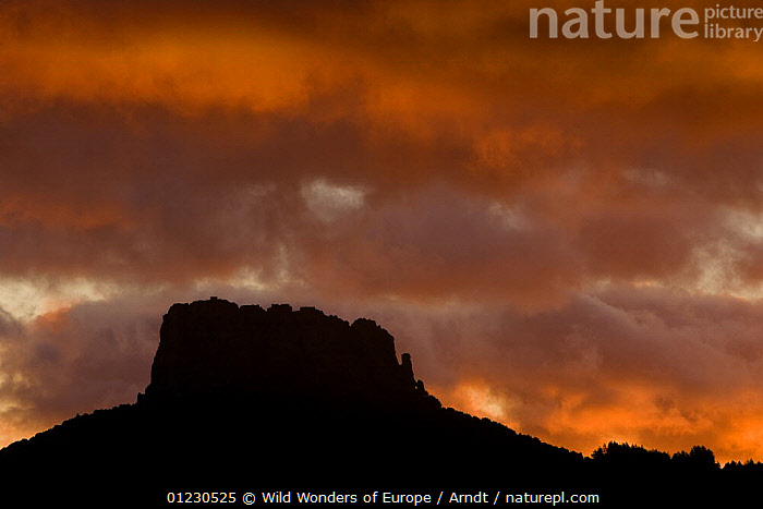 Monte Novo San Giovanni (1316m) at sunrise, Gennargentu National Park, Sardinia, Italy, November 2008, ATMOSPHERIC,EUROPE,INGO ARNDT,ITALY,LANDSCAPES,MOUNTAINS,NP,RED,RESERVE,ROCK FORMATIONS,SILHOUETTES,SKY,SUNRISE,WWE,National Park,Geology, Wild Wonders of Europe / Arndt