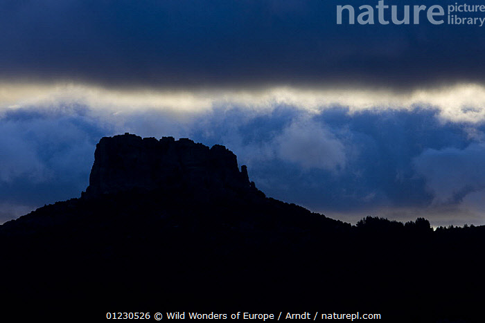 Monte Novo San Giovanni (1316m) at sunrise, Gennargentu National Park, Sardinia, Italy, November 2008, ATMOSPHERIC,BLUE,CLOUDS,EUROPE,INGO ARNDT,ITALY,LANDSCAPES,MOUNTAINS,NP,RESERVE,ROCK FORMATIONS,SILHOUETTES,SKY,SUNRISE,WWE,Weather,National Park,Geology, Wild Wonders of Europe / Arndt