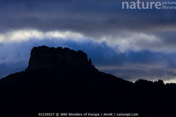 Monte Novo San Giovanni (1316m) at sunrise, Gennargentu National Park, Sardinia, Italy, November 2008, BLUE,CLOUDS,EUROPE,INGO ARNDT,ITALY,LANDSCAPES,MOUNTAINS,NP,RESERVE,ROCK FORMATIONS,SILHOUETTES,SUNRISE,WWE,Weather,National Park,Geology, Wild Wonders of Europe / Arndt