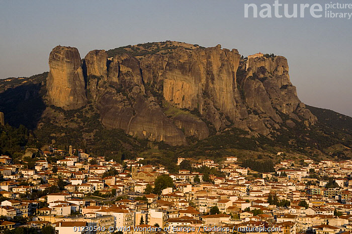 Kalampaka Town at sunset with cliff-top monastries in the background, Meteora, Greece, October 2008, AUTUMN,BUILDINGS,CLIFFS,EUROPE,GREECE,LANDSCAPES,MILAN RADISICS,ROCK FORMATIONS,SUNSET,TOWNS,WWE,Geology, Wild Wonders of Europe / Radisics