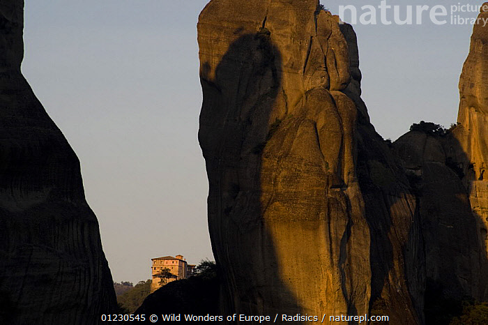 Cliffs at sunset, Roussanou Monastery in the background, Meteora, Greece, October 2008, BUILDINGS,CLIFFS,EUROPE,GREECE,LANDSCAPES,MILAN RADISICS,ROCK FORMATIONS,ROCKS,SUNSET,WWE,Geology, Wild Wonders of Europe / Radisics