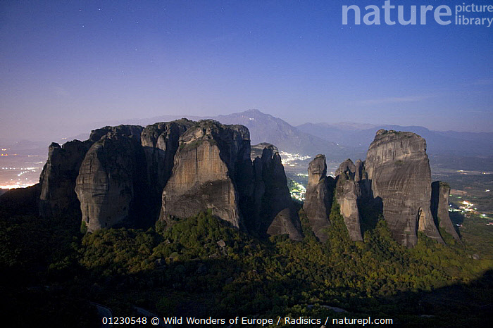 Cliffs at night in moonlight with cliff-top monastery, Meteora, Greece, October 2008, BUILDINGS,CLIFFS,EUROPE,GREECE,LANDSCAPES,LIGHTS,MILAN RADISICS,NIGHT,ROCK FORMATIONS,ROCKS,TOWNS,WWE,Geology, Wild Wonders of Europe / Radisics