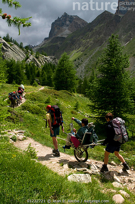 Hiking with handicapped people in the Alps, France, July 2008  ,  ADVENTURE,ALPINE,DISABILITY,DISABLED,EUROPE,FRANCE,GROUPS,LANDSCAPES,MOUNTAINS,PEOPLE,RECREATION,VERTICAL,WHEELCHAIR,WHEELCHAIRS,WOODLANDS  ,  Jean E. Roche