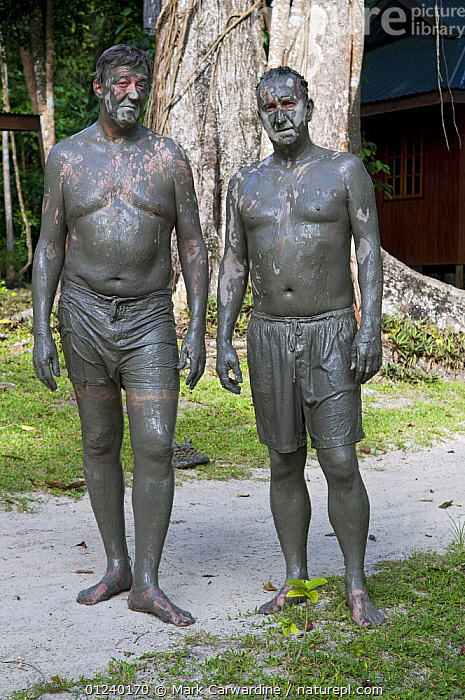 Stephen Fry and Mark Carwadine after a mud bath in Borneo, filming for BBC TV series 'Last Chance to See', March 2009  ,  ASIA,BATHING,HUMOROUS,INDONESIA,MUD,PEOPLE,VERTICAL,Concepts  ,  Mark Carwardine