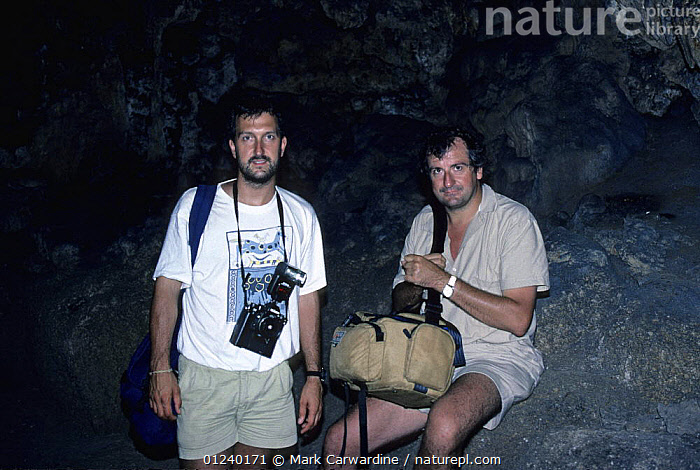 Mark Carwardine and Douglas Adams on location for BBC radio series 'Last chance to see' in Robinson Crusoe's cave, Juan Fernandez Islands, Chile, December 1988  ,  CAVES,PEOPLE,SOUTH AMERICA  ,  Mark Carwardine