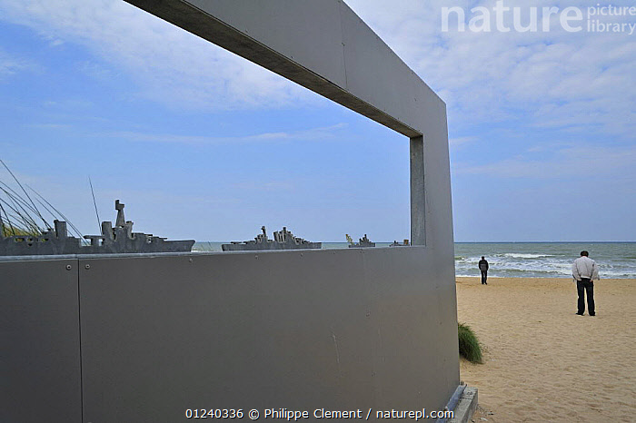 Tourists and modern sculpture on D-day landing beach, Juno beach, Courseulles-sur-Mer, Normandy, France, September 2008.  ,  ART,BEACHES,COASTS,ENGLISH CHANNEL,EUROPE,FRANCE,HISTORICAL,LANDSCAPES,NORTH SEA,PEOPLE  ,  Philippe Clement