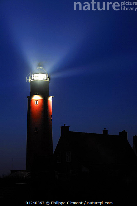The Cocksdorp lighthouse shining at night, Texel, the Netherlands, April 2009  ,  BEAM,BUILDINGS,COASTS,EUROPE,HOLLAND,LIGHT,LIGHTHOUSES,LIGHTS,NIGHT,NORTH SEA,SILHOUETTES,VERTICAL,Catalogue1  ,  Philippe Clement