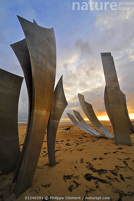 The Omaha Beach monument Les Braves, memorial to the D-Day landings, on the beach at Saint-Laurent-sur-Mer at sunset, Normandy, France, September 2008  ,  ART,BEACHES,ENGLISH CHANNEL,EUROPE,FRANCE,HISTORICAL,NORTH SEA,SCULPTURE,SCULPTURES,VERTICAL  ,  Philippe Clement