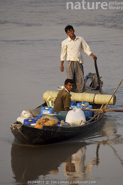 Men in boat with containers of shrimp fry. Khulna Province, Bangladesh. March 2006, ASIA,BANGLADESH,BOATS,COASTS,COMMERCIAL,CRUSTACEANS,INVERTEBRATES,MANGROVES,MANGROVE SWAMPS,MARINE,OPEN BOATS,PEOPLE,SHRIMP FARMING,SHRIMPS,STANDING,VERTICAL,INDIAN-SUBCONTINENT, Tim Laman