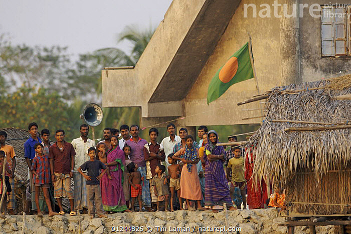 Villagers from Nolian Village watching our boat and waving to us, Khulna Province, Bangladesh, March 2006, ASIA,BANGLADESH,BUILDINGS,COASTS,CROWDS,GROUPS,PEOPLE,SUNDARBAN,SUNDARBANS,SUNDERBANS,INDIAN-SUBCONTINENT, Tim Laman
