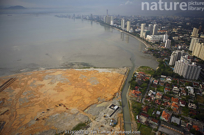 Aerial view of the waterfront of Georgetown, Penang, Malaysia and new coastal development. Georgetown, Pulau Pinang, Malaysia. May 2006, ASIA,BUILDINGS,CITIES,COASTS,LANDSCAPES,MALAYSIA, Tim Laman
