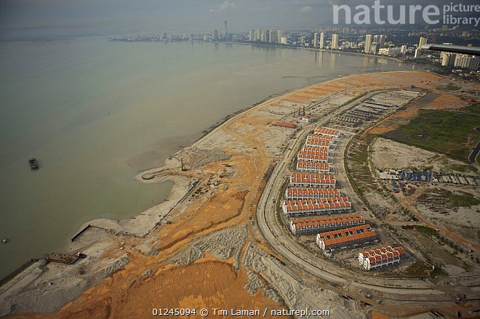 Aerial view of the waterfront of Georgetown, Penang, Malaysia and new coastal development.