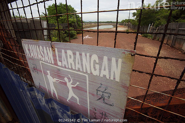 No trespassing sign at the gate to a major industrial shrimp farming complex, carved out of the mangroves. Kedah, Malaysia.  May 2006, ASIA,COMMERCIAL,DEFORESTATION,ENVIRONMENTAL,LANDSCAPES,MALAYSIA,MANGROVE,MANGROVES,SIGNS, Tim Laman