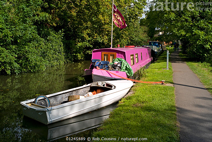 Boats moored by the towpath on the Oxford Canal at Oxford, UK. August 2009., CANAL BOATS,CANALS,FOOTPATHS,MIXED BOATS,MOORED,OPEN BOATS,PROVISIONS,RIVERS,SUMMER,WOODLANDS,BOATS, BARGES, Rob Cousins