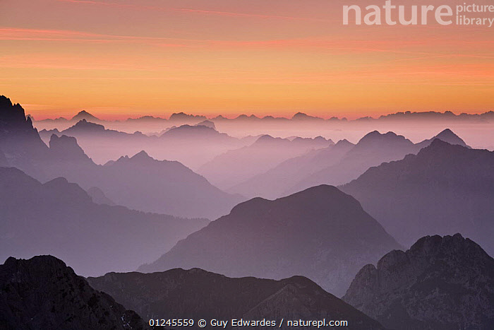 The Julian Alps at sunset, looking north into Italy from Mangrt at 2500m, Triglav National Park, Gorenjska, Slovenia, October 2008, ATMOSPHERIC,EUROPE,HIGH ANGLE SHOT,LANDSCAPES,MIST,MOUNTAINS,NP,RESERVE,National Park, Guy Edwardes