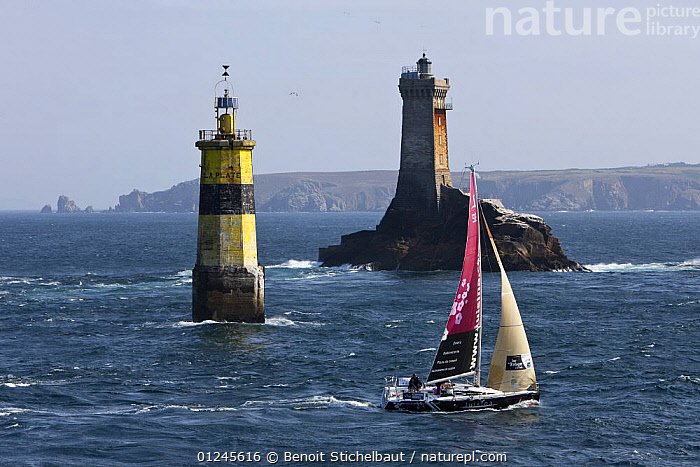 """Luisina"" (Eric Drouglazet and Laurent Pellecuer) passing marker and Phare De La Vieille (Lighthouse) at Raz De Sein, Finistere, Brittany, during the Tour de Bretagne, September 2009., ALONE,BRITTANY,COASTS,EUROPE,FIGARO B�N�TEAU 2,FIGARO BENETEAU II,FIGAROS,FINIST�RE,FRANCE,LIGHTHOUSES,MARKERS,PROFILE,RACES,SAILING BOATS,YACHTS,CONCEPTS,BOATS,SAILING-BOATS,BUILDINGS ,NAVIGATION, Benoit Stichelbaut"
