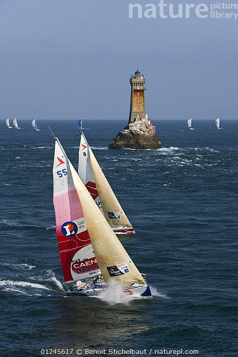 Yachts passing lighthouse at Raz De Sein, Finistere, Brittany, during the Tour de Bretagne, September 2009., AERIALS,BRITTANY,CHOPPY,COASTS,EUROPE,FIGARO B�N�TEAU 2,FIGARO BENETEAU II,FIGAROS,FINIST�RE,FRANCE,LIGHTHOUSES,RACES,RACING,SAILING BOATS,SPRAY,TWO,VERTICAL,YACHTS,BOATS,SAILING-BOATS,BUILDINGS, Benoit Stichelbaut