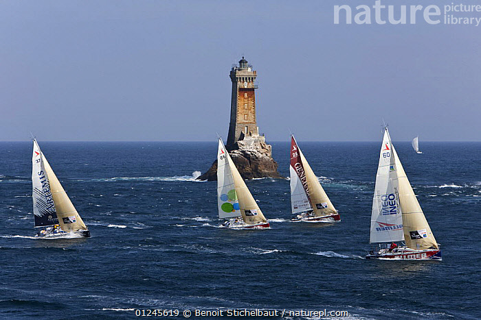 Yachts passing lighthouse at Raz De Sein, Finistere, Brittany, during the Tour de Bretagne, September 2009., AERIALS,BRITTANY,CHOPPY,COASTS,EUROPE,FIGARO B�N�TEAU 2,FIGARO BENETEAU II,FIGAROS,FINIST�RE,FLEETS,FOUR,FRANCE,LIGHTHOUSES,RACES,RACING,SAILING BOATS,YACHTS,BOATS,SAILING-BOATS,BUILDINGS, Benoit Stichelbaut
