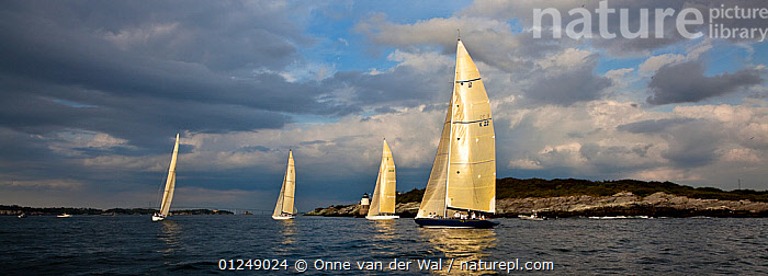 Yachts sailing near the Castle Hill lighthouse, 12 Metre World Championships, Newport, Rhode Island, USA. September 2009.  ,  12 METERS,12 METRES,COASTS,FOUR,LANDSCAPES,METER,NORTH AMERICA,PANORAMIC,RACES,SAILING BOATS,USA,YACHTS,BOATS,SAILING-BOATS  ,  Onne van der Wal