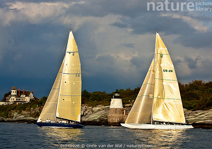 Yachts sailing near the Castle Hill lighthouse, 12 Metre World Championships, Newport, Rhode Island, USA. September 2009.  ,  12 METERS,12 METRES,COASTS,LIGHTHOUSES,METER,NORTH AMERICA,PROFILE,RACES,SAILING BOATS,TWO,USA,YACHTS,BOATS,SAILING-BOATS,BUILDINGS  ,  Onne van der Wal