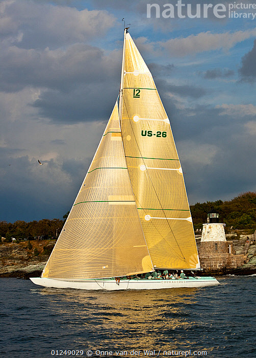 Yacht sailing near the Castle Hill lighthouse, 12 Metre World Championships, Newport, Rhode Island, USA. September 2009.  ,  12 METERS,12 METRES,COASTS,LANDSCAPES,LIGHTHOUSES,METER,NORTH AMERICA,PROFILE,SAILING BOATS,USA,VERTICAL,YACHTS,BOATS,SAILING-BOATS,BUILDINGS  ,  Onne van der Wal