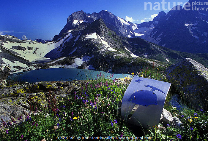 Klukhor lake on the passage to Abkhazia, with alpine flowers and a mountain sign in the foreground, Teberdinsky Nature Preserve, Karachayevo Cherkessiya,  Western Caucasus, Russia, July 2006  ,  ASIA,FLOWERS,LAKES,LANDSCAPES,MOUNTAINS,PLANTS,RESERVE,RUSSIA,SNOW,SUMMER  ,  Konstantin Mikhailov