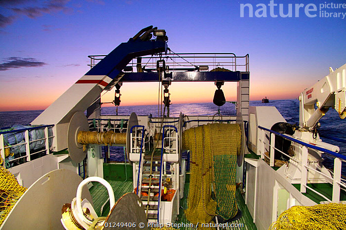 Looking aft on a trawler at dusk, North Sea, September 2009. Property released.  ,  ABOARD,AFTDECKS,BOATS,DUSK,EUROPE,FISHERIES,FISHING BOATS,LIGHTS,North Sea,SUNSET,TRAWLERS, WORKING-BOATS , WORKING-BOATS , WORKING-BOATS  ,  Philip Stephen