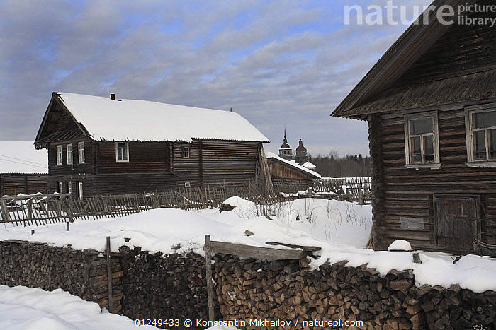 Snow covered houses in traditional Russian village, Chistyi Dor, Russky Sever NP, Vologda Province, Russia, March 2009  ,  BUILDINGS,EUROPE,LANDSCAPES,RESERVE,RUSSIA,SNOW,VILLAGES,WINTER  ,  Konstantin Mikhailov