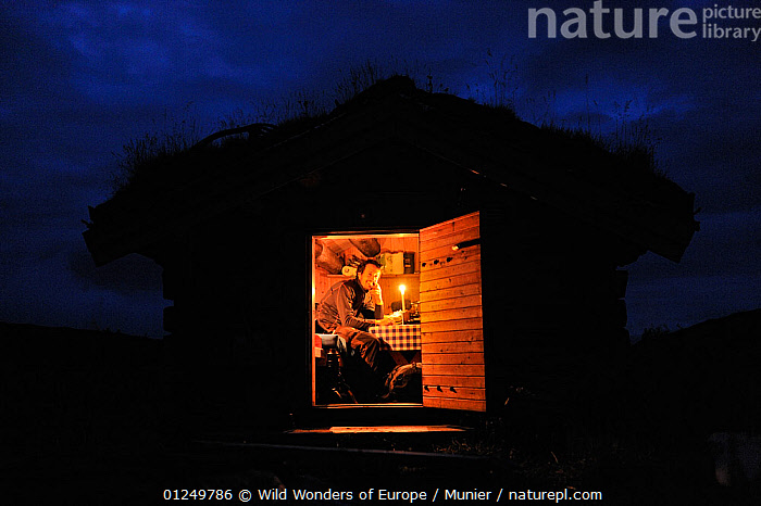 Photographer, Vincent Munier, sitting in small traditional cabin with a grass roof, at night, Forollhogna National Park, Norway, on location for Wild Wonders of Europe, September 2008, BUILDINGS,EUROPE,LANDSCAPES,NIGHT,NORWAY,NP,PEOPLE,PORTRAITS,RESERVE,SCANDINAVIA,TRADITIONAL,TUNDRA,vincent munier,WWE, Scandinavia,National Park, Wild Wonders of Europe / Munier