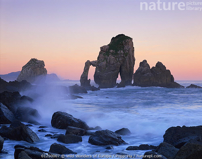 Rock arches in the sea,  Gaztelugatxe, Basque country, Bay of Biscay, Spain, October 2008.  ,  ATLANTIC,BAY OF BISCAY,COASTS,EROSION,EUROPE,GEOLOGY,LANDSCAPES,ROCK FORMATIONS,SPAIN,SUNSET,VERENA POPP HACKNER,WAVES,WWE,Marine  ,  Wild Wonders of Europe / Popp-Ha