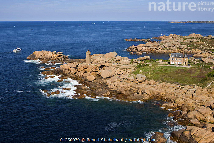 Mean Ruz point and lighthouse, Ploumanach, Cotes d'Armor. August 2009.  ,  AERIALS,Brittany,COASTS,EUROPE,FRANCE,LANDSCAPES,LIGHTHOUSES,ROCKS,BUILDINGS  ,  Benoit Stichelbaut