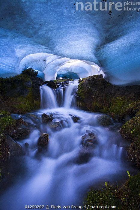 Ice cave with melting ice and waterfall, The Bailey Range, Olympic National Park, Washington, USA. Veolia Environnement Wildlife Photographer of the Year 2009: Highly Commended in the 'Wild Places' category  ,  ATMOSPHERIC,BLUE,CALM,ICE,MOODY,NORTH AMERICA,NP,SPRING,VERTICAL,WATER,National Park Awards,National Park award-winning, competition,National Park  ,  Floris van Breugel