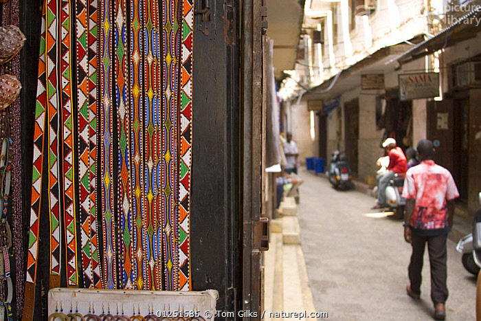Traditional beaded belts for sale in Stone Town, Zanzibar, Tanzania. August 2008.  ,  AFRICA,EAST AFRICA,PEOPLE,STREET,TOWNS,TRADE  ,  Tom Gilks