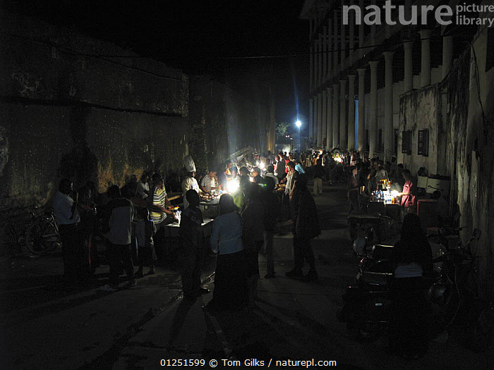 Food stalls at night, next to the house of wonders, Stone Town, Zanzibar, Tanzania. August 2008.  ,  AFRICA,BUILDINGS,EAST AFRICA,MARKETS,NIGHT,PEOPLE,TRADE  ,  Tom Gilks